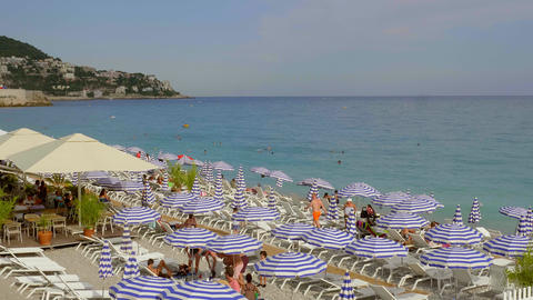 People sunbathing at the beach of Nice - CITY OF NICE, FRANCE - JULY 10, 2020 Live Action