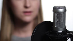 Closeup female singer recording track in studio Footage