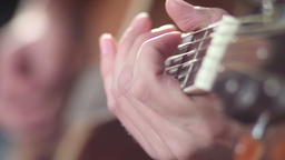 Playing guitar - fingers on fretboard Footage