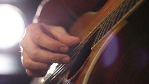 Performing chords on acoustic guitar Footage