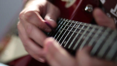 Guitarist hand strumming at electric guitar string Footage