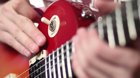 Rock musician with electric guitar fretting chord Footage