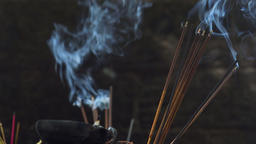 Burning incense joss sticks at temple. Traditional religious offering Footage