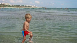 Little boy having fun on the beach, Constanta, Romania Footage