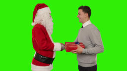 Young Businessman receiving a present from Santa Claus, shaking hands, Green Scr Footage