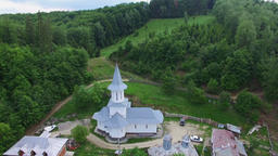 Christian church on top af a green hill, aerial view Footage