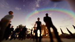 Crowd walking at sunset, low pov camera flying Animation