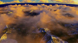 Cruising above clouds and snowy mountain peaks Animation