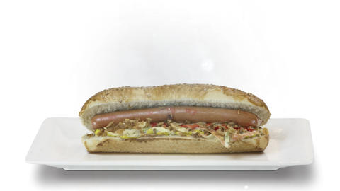 Delicious Hot dog with a sausage on a fresh rolls with ketchup on white white on gray background Live Action
