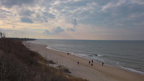 Sandy beach on Baltic Sea coast at cloudy evening Live Action