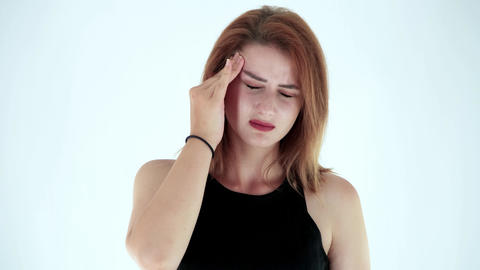 Portrait of stressed attractive young woman having terrible strong headache isolated on white ライブ動画