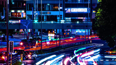 A night timelapse of the urban city street in Aoyama long shot panning Live Action
