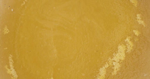Rotation and zoom of natural beeswax. Close-up. Natural beeswax melted from Live Action