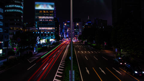 A night timelapse of the urban city street in Aoyama wide shot zoom Live Action