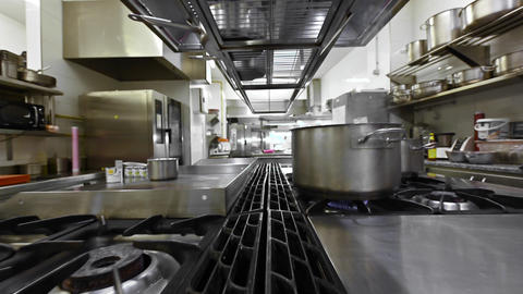 Preparing and cooking food in a commercial kitchen. Zoom out, Dolly shot camera Live Action
