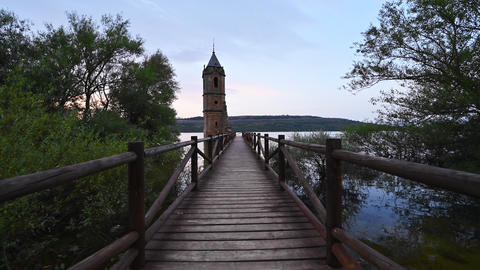 point of view, walking in a pier with a scenic sunken church ruins located in Live Action