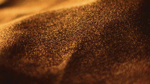 Golden shiny fabric texture close-up for fashion brand as holiday glitter Live Action