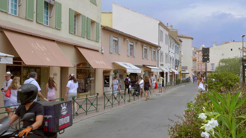Luxury shops of all famous designers in Saint Tropez- ST TROPEZ, FRANCE - JULY Live Action