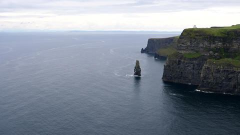 Cliffs of Moher panning from island in the sea Live Action