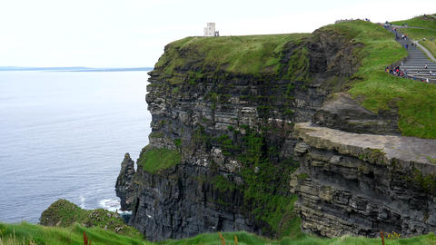 Cliffs of Moher People on path to the tower Live Action