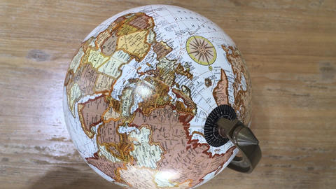 Retro globe item top view on table Live Action