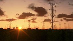 Electricity pillars at sunrise Animation