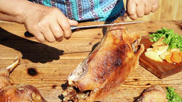 Roasted Goose Meat Being Chopped On Wooden Table Footage