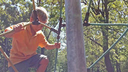 Little boy bouncing on ropes Footage