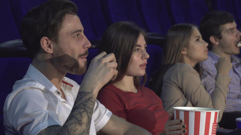 Two young couples watching the premiere of a new film Live Action