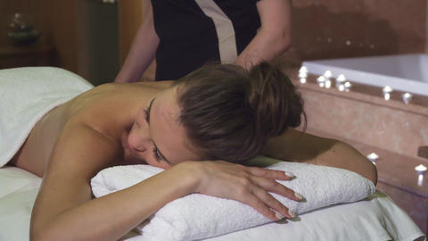 A pleasant masseuse makes the girl a professional relaxing massage Live Action