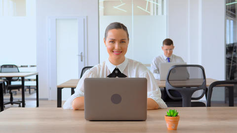 portrait businesswoman shows symbol like at workplace Live Action