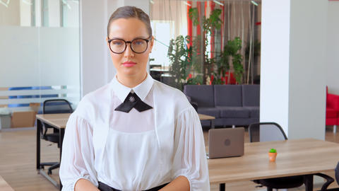 successful entrepreneur in elegant shirt and glasses office Live Action