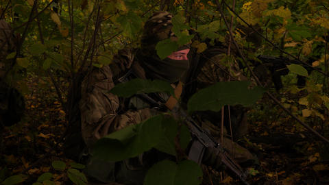 Masked commandos in the forest. A soldier with a rifle is watching closely ライブ動画