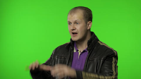 Expressive rocker man screaming and shouting. Studio portrait of handsome person Live Action
