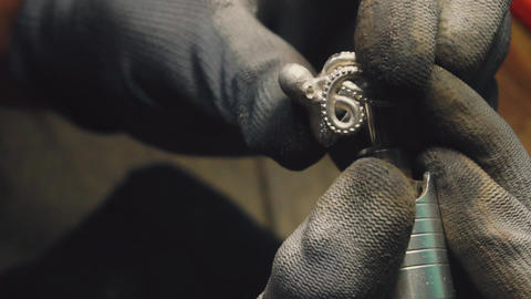 1080p.HD-60p. Slow mo. Close-up partial view of jeweler making a silver ring Live Action