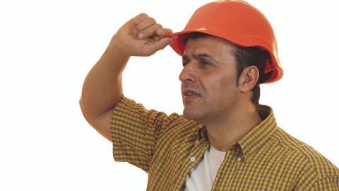 Professional contractor looking shocked wearing hardhat Live Action