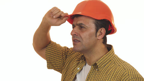 Mature professional builder in hardhat looking disappointed Live Action
