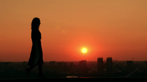 woman walking on the street cityscape at sunrise dawn in town Live Action