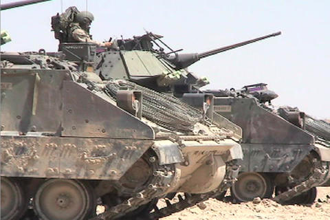A line of American army tanks sits awaiting combat... Stock Video Footage