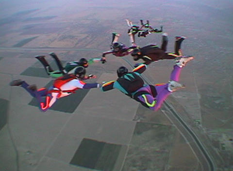 Ten skydivers free-fall in formation Footage