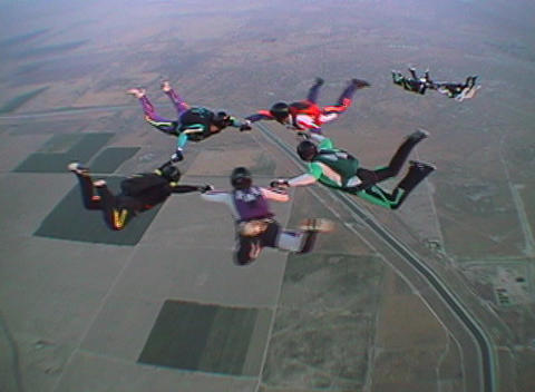 Ten skydivers free-fall in formation Stock Video Footage