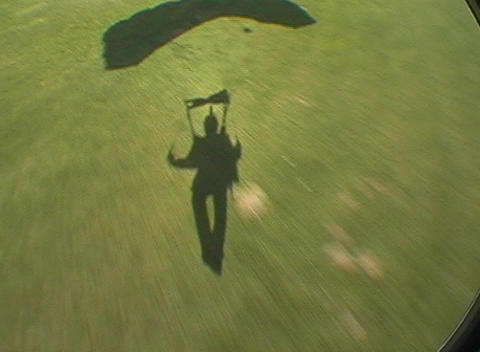 Skydivers land in a grassy field Stock Video Footage