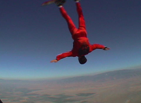 A skydiver performs skyboarding maneuvers Stock Video Footage