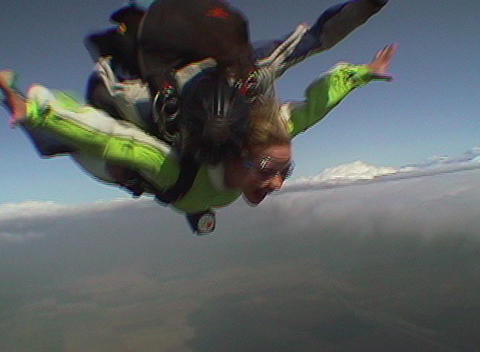 Tandem skydivers free fall and deploy their parachute Stock Video Footage