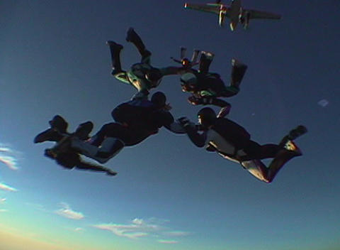 Skydivers jump from an airplane and hold a formation Stock Video Footage
