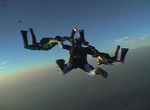 Skydivers jump from an airplane and hold a formation Footage