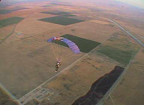 A skydiver floats through the air Stock Video Footage