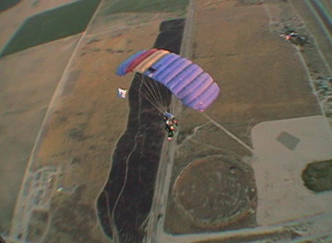 A skydiver floats through the air Live Action