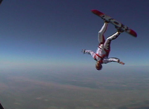 A skydiver jumps from an airplane and performs... Stock Video Footage