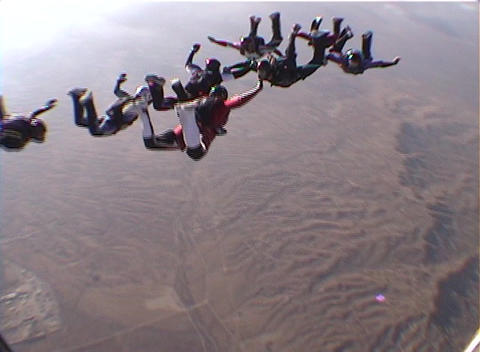 Eight skydivers perform group maneuvers while free-falling Footage
